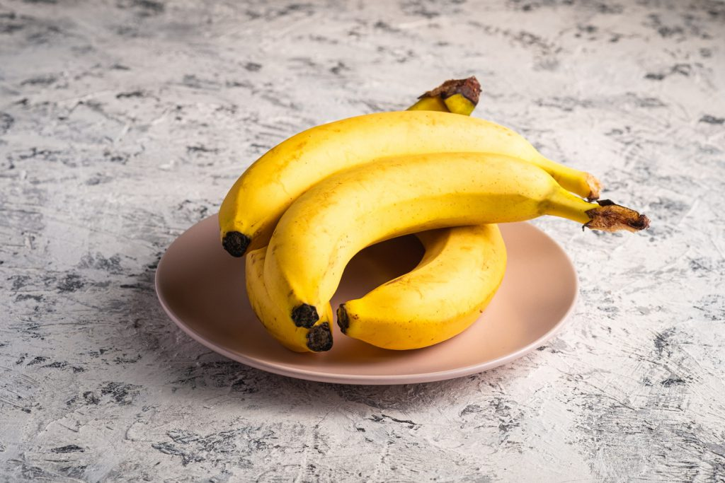 offering banana puree - mashed banana stock pictures, royalty-free photos & images